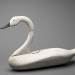 The maker of this swan decoy has been disputed for years. Attributed to Havre de Grace carver Samuel T. Barnes, some experts have argued that it far more strongly resembles the work of Barnes' contemporary James T. Holly. Regardless of its maker, the decoy's graceful form, sinuous neck and stately proportions belie its practical origins as a hunting tool. James T. Holly (1849 – 1935) or Samuel T. Barnes (1857 – 1926), Whistling swan decoy, c. 1890. Pine with steel fastenings, 50.8 x 81.3 x 26.7 cm. Gift of Mrs. Sifford Pearre, 1969.50.1.