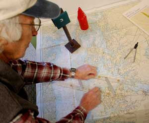 Captain Jerry Friedman, a USCG-licensed Master—shown here using parallel rulers to chart a course—is teaching a weekend chart navigation course at the Chesapeake Bay Maritime Museum to help boaters better understand how to plan for a cruise using navigation charts, course plotting, and navigational aids when electronics are not available.