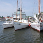 The Chesapeake Bay Maritime Museum's floating fleet, including from left, the 1934 draketail (or dovetail) Martha, the 1909 log bottom crab dredger Old Point, and the 1889 log bottom bugeye Edna E. Lockwood, will be featured in a segment of the February 5, 8 p.m. broadcast of Maryland Public Television's Chesapeake Collectibles series. The fleet is part of the largest collection of Chesapeake Bay watercraft in the world, and can be seen along CBMM's waterfront campus in St. Michaels, MD.
