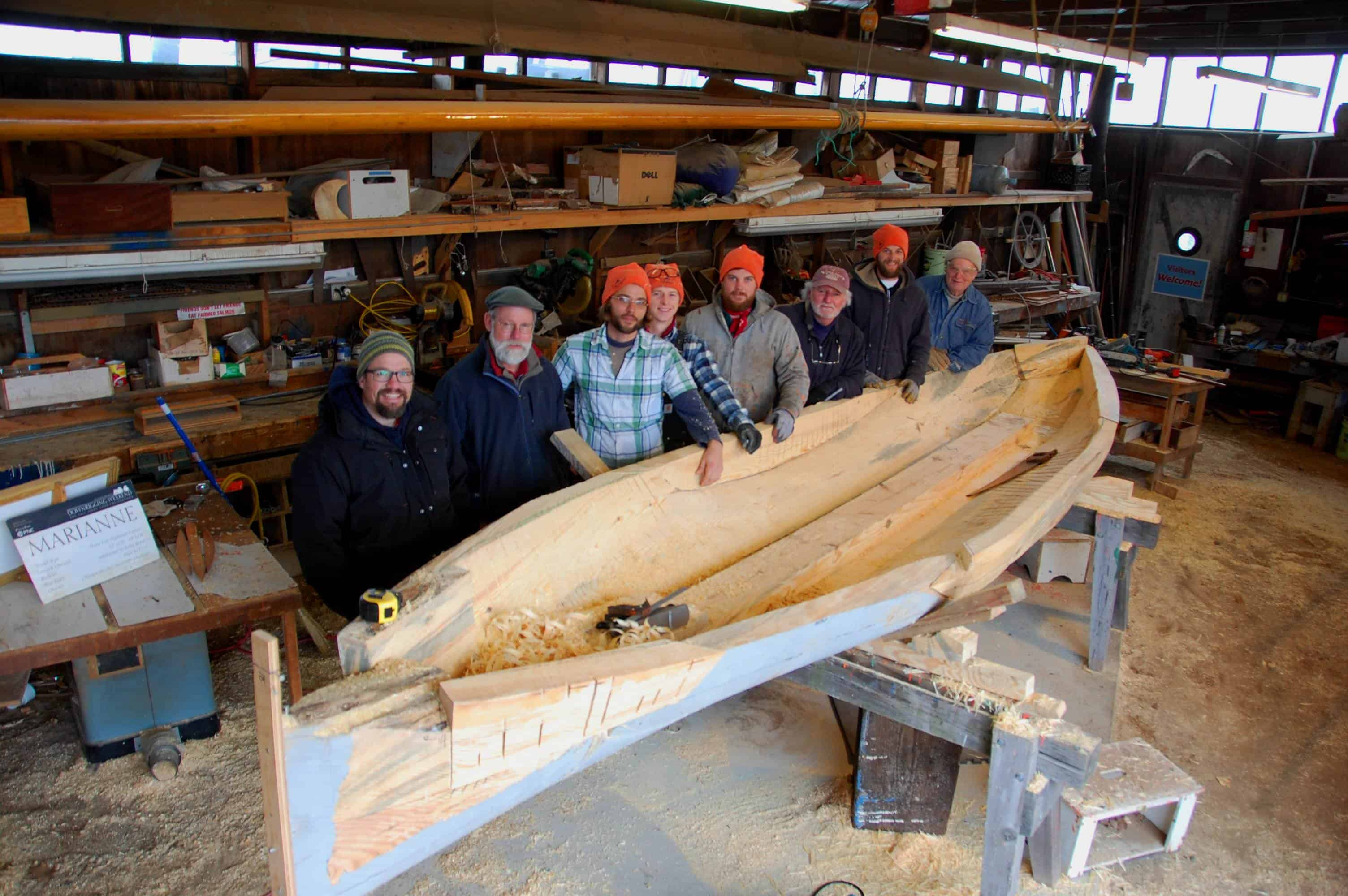 Chesapeake Bay Maritime Museum shipwrights, apprentices, and volunteers take a break from building a new log canoe at the museum in St. Michaels, MD. Pictured, from left: Apprentice Brooke Ricketts; Assistant Curator of Watercraft Rich Scofield; Apprentices James DelAguila and Chris Baden; Boatshop Manager Michael Gorman; Volunteer Mike Corliss; Vessel Maintenance Assistant Joe Connor; and Volunteer Cliff Stretmater.