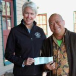 Chesapeake Bay Maritime Museum President Kristen Greenaway, left, recently accepted an annual fund donation from Marcoritaville Sushi Bar & American Grill owner Marc Chew, right.