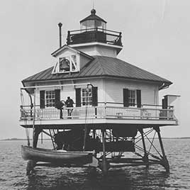 On January 11, 1877, the first Hooper Strait Lighthouse, a square screwpile structure, was knocked from its foundation by moving ice, after just 10 years of service. Keeper John Cornwell and his assistant Alexander S. Conway escaped in a small boat, but the ice prevented them from reaching land. They were rescued 24 hours later by a passing sloop. Despite the trying experience, Cornwell again became the keeper when the second Hooper Strait Lighthouse—which now is part of the Chesapeake Bay Maritime Museum—was completed in 1879.