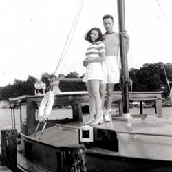 Tom and Eleanor Requardt are standing together on the deck of their cruiser, Isabel, c. 1935. Photographer unknown. Collection of the Chesapeake Bay Maritime Museum, St. Michaels, MD. Gift of J. Thomas and Eleanor F. Requardt.