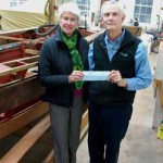 Chesapeake Bay Maritime Museum President Kristen Greenaway, left, was recently presented with an annual fund donation from the Antique & Classic Boat Society's Chesapeake Bay Chapter member Frank Hopkinson, right. The organization partners with CBMM to bring the Antique & Classic Boat Festival to St. Michaels each Father's Day weekend. The donation is supporting more on-the-water activities for CBMM guests through a new boat rental program, which is expected to launch this summer. CBMM continues to seek donations to meet its annual fundraising needs, with donations received by February 28 going towards the museum's 2014 annual fund. The museum is celebrating its 50th anniversary in 2015, with a kick-off event and an exhibition opening set for Memorial Day weekend on May 23, 2015, the anniversary of the museum's beginnings.