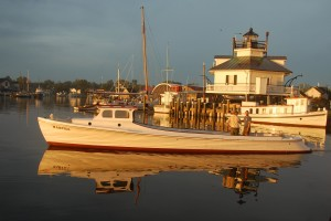 Coming up on Saturday, May 23, the Chesapeake Bay Maritime Museum will be offering boat rides on many of the historic boats in its floating fleet, including the dovetail Martha, shown here. Scenic river cruises will be offered during the Party on the Point: 50 Years on the Bay festival, which kicks off a year-long 50th live music by the XPDs, regional foods, Rosie's Tavern, family activities, and more. anniversary celebration for the Museum and features