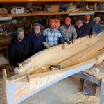 Chesapeake Bay Maritime Museum shipwrights, apprentices, and volunteers take a break from constructing a three-log canoe at the museum in St. Michaels, Md. The two-masted log hull sailing canoe is the first to be built in more than 35 years, and will be launched at CBMM on Wednesday, April 22, with the public invited to help celebrate the occasion. The log canoe—to be christened Bufflehead—will launch immediately following the museum's Blessing of the Fleet ceremony, which begins at 5 p.m. Pictured, from left: Apprentice Brooke Ricketts; Assistant Curator of Watercraft Rich Scofield; Apprentices James DelAguila and Chris Baden; Boatshop Manager Michael Gorman; Volunteer Mike Corliss; Vessel Maintenance Assistant Joe Connor; and Volunteer Cliff Stretmater. For more information, visit www.cbmm.org.