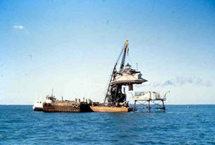 The 1879 Hooper Strait Lighthouse being placed on a barge, to be moved up to CBMM in 1966.