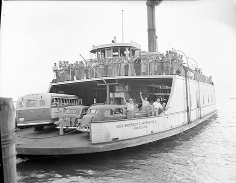 the ferry Governor Emerson C. Harrington II departing Claiborne, an important terminal for cross-bay ferries in the twentieth century. Before the Chesapeake Bay Bridge opened in 1952, a system of ferries daily carried people, goods, and vehicles, connecting Annapolis to Claiborne, and later Sandy Point to Kent Island, with a shorter crossing from Romancoke on Kent Island to Claiborne. Emerson C. Harrington II served this shorter crossing. Photograph by H. Robins Hollyday, c. 1948, collection of Talbot Historical Society