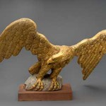 Eagle, wooden carving, from unknown tugboat, brought to St. Michaels by Robert Dryden, owner of Eagle House, and placed on the roof (c. 1908), where it remained for 57 years. The eagle was restored in 1965. Collection of the Chesapeake Bay Maritime Museum, St. Michaels, MD, 1966-78-1.