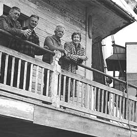 The founders of the Chesapeake Bay Maritime Museum stand on the deck of the 1879 Hooper Strait Lighthouse in 1966, shortly after it was moved to Navy Point.